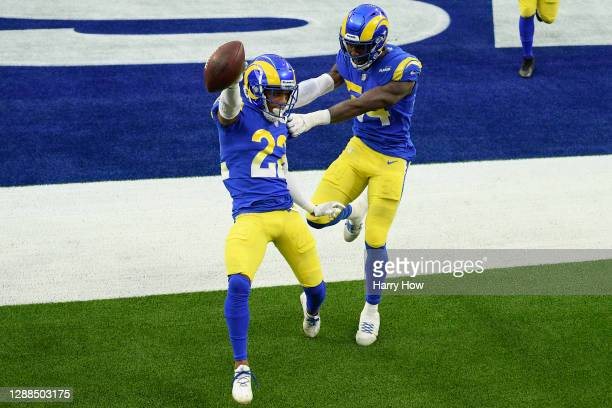 Troy Hill of the Los Angeles Rams celebrates with Leonard Floyd after returning a fumble recovery for a touchdown during the third quarter against...