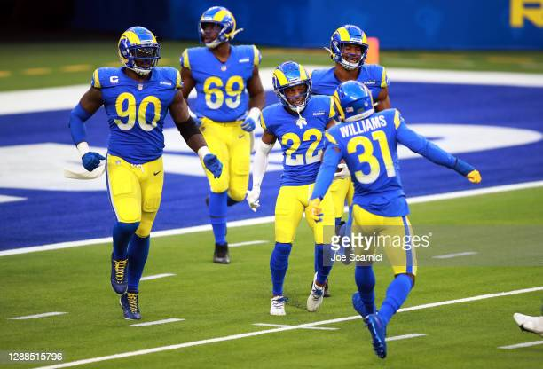 Troy Hill of the Los Angeles Rams celebrates with teammates after returning a fumble recovery for a touchdown during the third quarter against the...