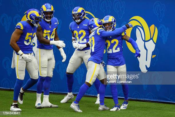Troy Hill of the Los Angeles Rams celebrates with teammates after returning an interception for an 84-yard touchdown during the second quarter...