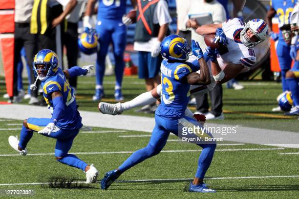 Troy Hill of the Los Angeles Rams looks back as teammate John Johnson tackles Tyler Kroft of the Buffalo Bills during the third quarter at Bills...