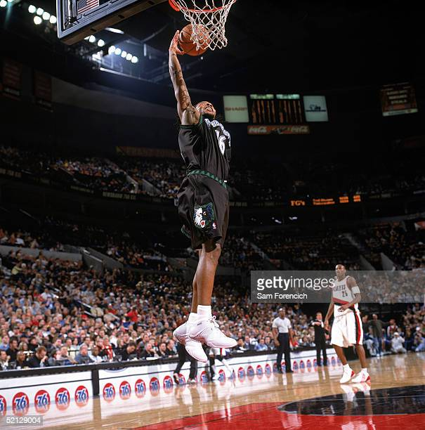 Troy Hudson of the Minnesota Timberwolves takes the ball to the basket during the game against the Portland Trail Blazers at The Rose Garden on...
