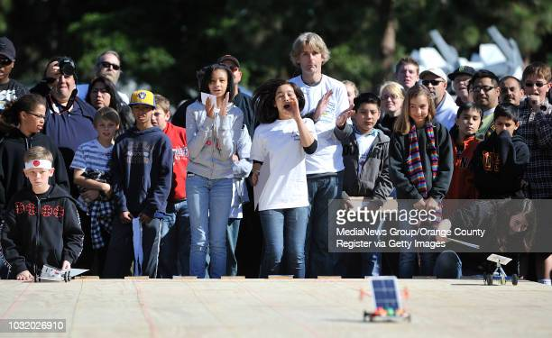 BEACH CALIF USA Troy Johnson left and Jamie Hutson center of Bethany Lutheran School cheer on their solar vehicle in the second annual Solar Grand...