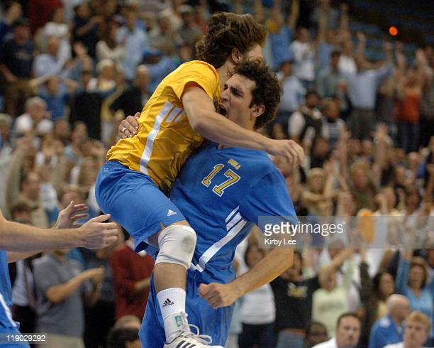 Troy Ker of UCLA jumps into arms of Allan Vince after the Bruins' 30-20, 30-24, 30-27 victory over Penn State in NCAA men's volleyball championship...
