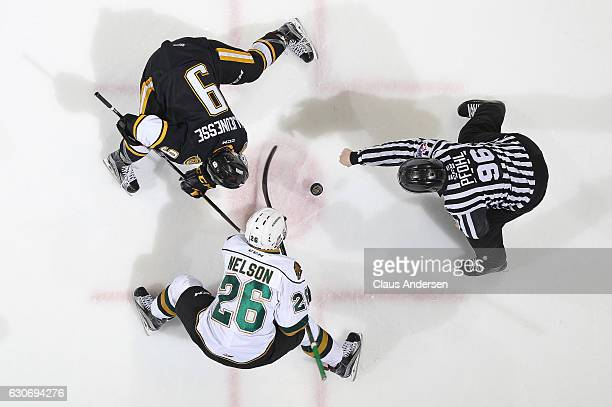 Troy Lajeunesse of the Sarnia Sting takes a faceoff against Josh Nelson of the London Knights during an OHL game at Budweiser Gardens on December 30...