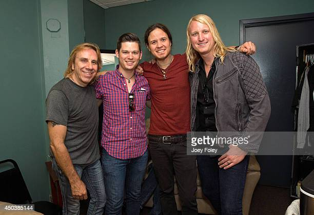 Troy Luccketta of Tesla Andrew Vollmer of 650 North Dave Rude of Tesla and Chris Bultman of 650 North hanging out backstage in Tesla's dressing room...
