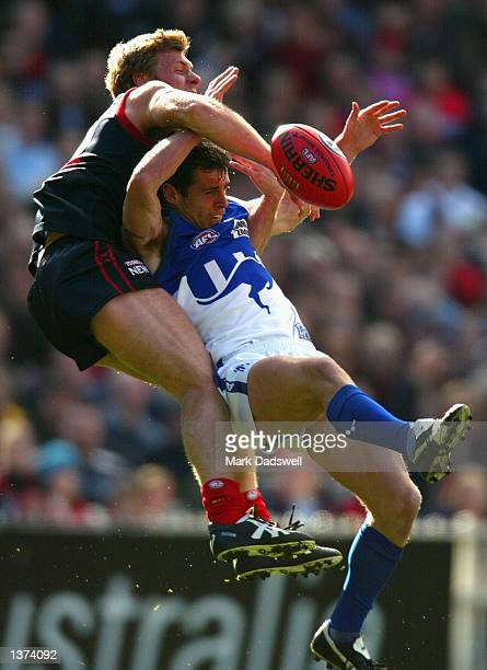 Troy Makepeace for the Kangaroos contests for the ball against Peter Vardy for the Demons during the Second Elimination AFL Final match between the...