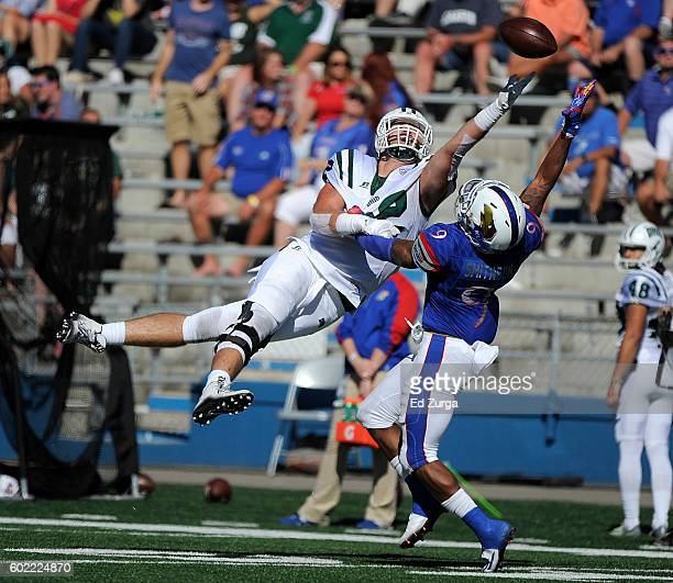 Troy Mangen of the Ohio Bobcats goes up for a pass against Fish Smithson of the Kansas Jayhawks in the third quarter at Memorial Stadium on September...
