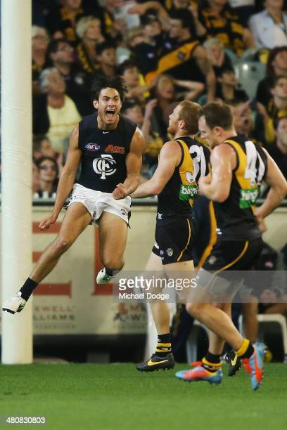 Troy Menzel of the blues celebrates a goal during the round two AFL match between the Richmond Tigers and the Carlton Blues at Melbourne Cricket...
