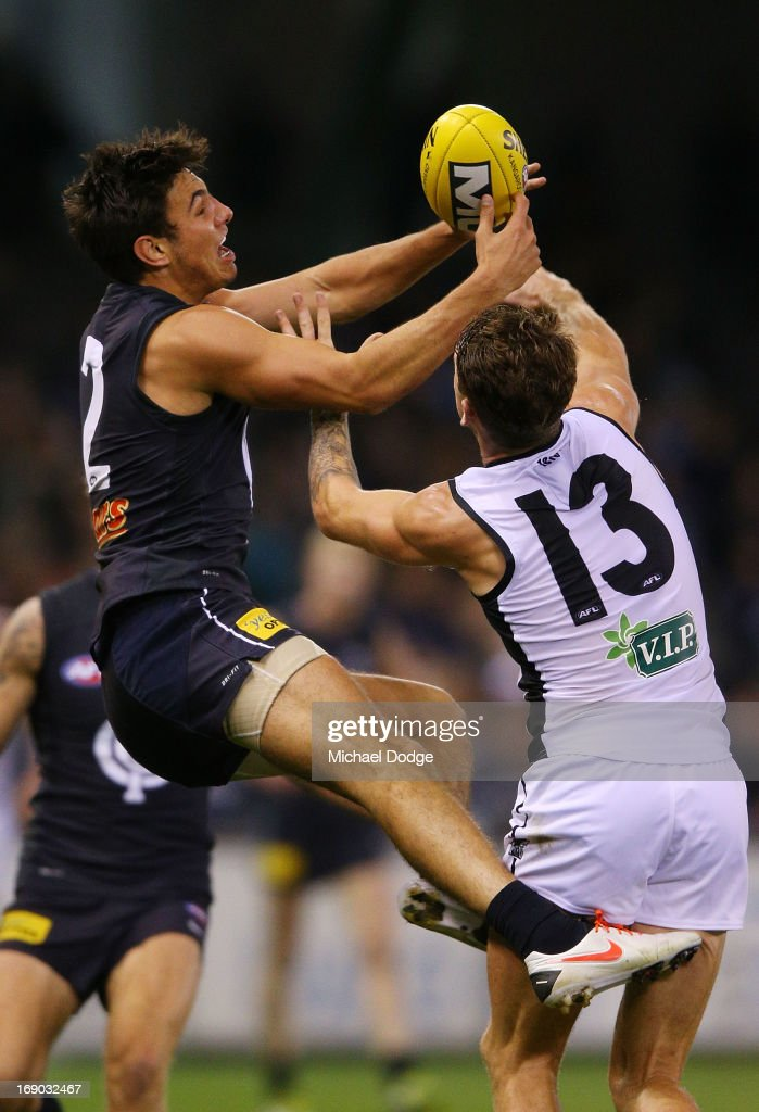 Troy Menzel (L) of the Blues contests for the ball against Cameron O'Shea of Port Adelaide during the round eight AFL match between the Carlton Blues and Port Adelaide Power at Etihad Stadium on May 19, 2013 in Melbourne, Australia.