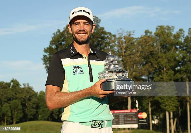Troy Merritt holds the championship trophy after winning the Quicken Loans National at the Robert Trent Jones Golf Club on August 2 2015 in...