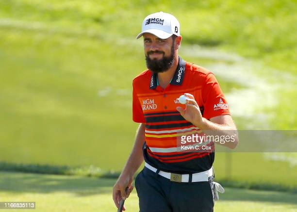 Troy Merritt of the United States reacts after a putt on the fifth green during the first round of The Northern Trust at Liberty National Golf Club...