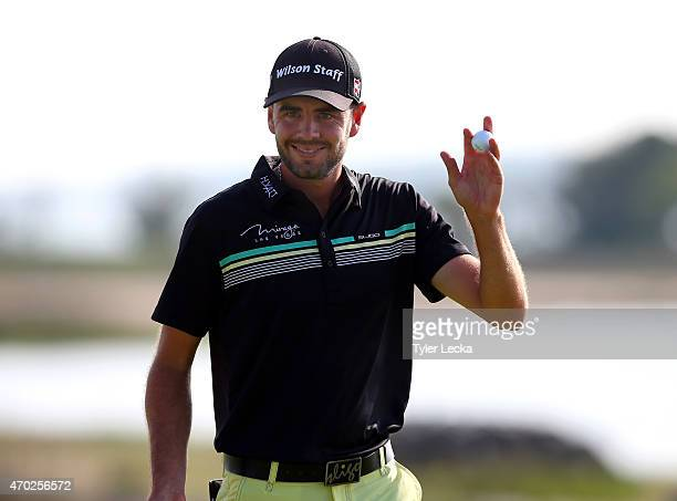 Troy Merritt waves to the gallery after making a par on the 18th hole during the third round of the RBC Heritage at Harbour Town Golf Links on April...