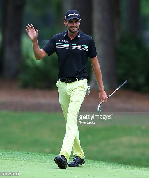 Troy Merritt waves to the gallery after making a par on the seventh hole during the third round of the RBC Heritage at Harbour Town Golf Links on...