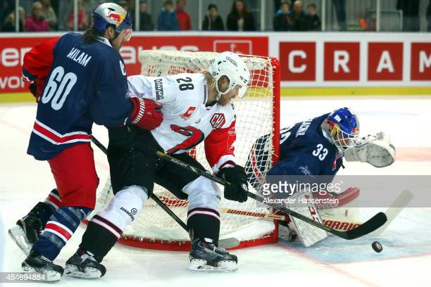 Troy Milam of Salzburg and his goalie Luka Gracnar fights with Miika Lahti of Jyvaskyla during the Champions Hockey League group 1 between Red Bull...