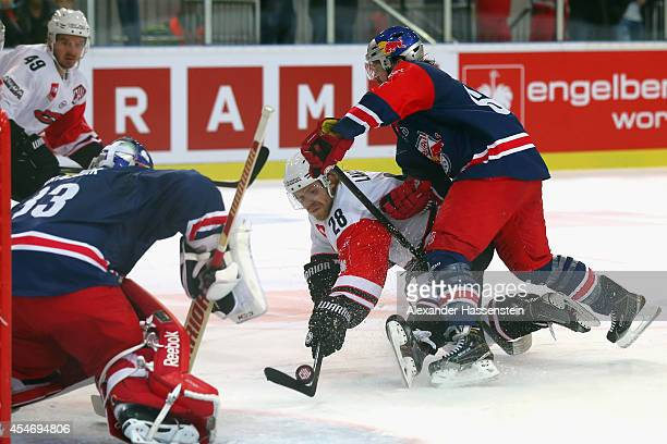 Troy Milam of Salzburg fights with Miika Lahti of Jyvaskyla during the Champions Hockey League group 1 between Red Bull Salzburg and JYP Jyvaskyla at...