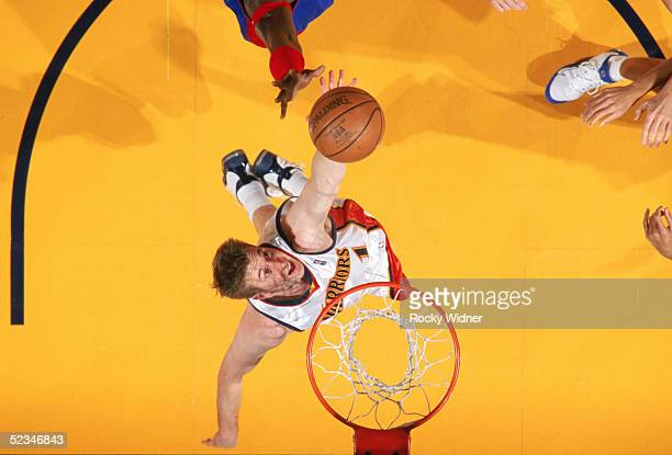 Troy Murphy of the Golden State Warriors goes up for a rebound during a game against the Detroit Pistons at The Arena in Oakland on February 27 2005...