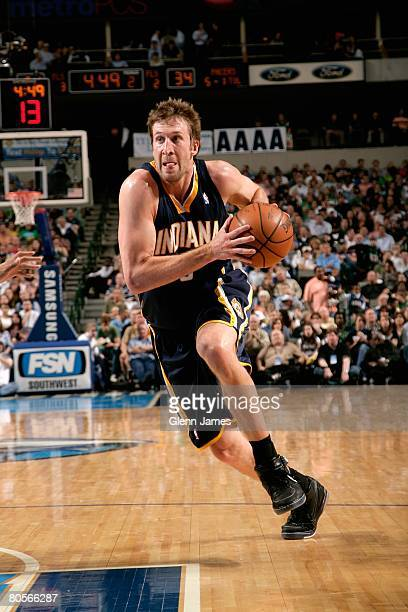 Troy Murphy of the Indiana Pacers drives to the basket during the game against the Dallas Mavericks on March 14 2008 at American Airlines Center in...