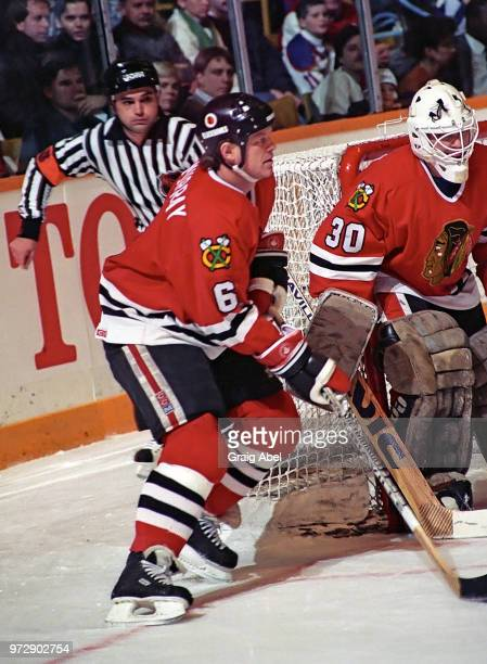 Troy Murray and Alain Chevrier of the Chicago Black Hawks skate against the Toronto Maple Leafs during NHL game action on December 23 1989 at Maple...