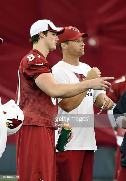 Troy Niklas of the Arizona Cardinals talks with assistant special teams and assistant tight ends coach Steve Heiden during Rookie Minicamp practice...
