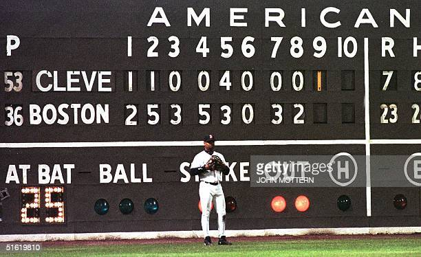 Troy O'Leary of the Boston Red Sox stands in front of the score board which shows the final score of game four of the American League Division Series...
