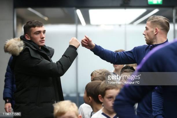 Troy Parrott and Toby Alderweireld of Tottenham Hotspur during the Premier League match between Tottenham Hotspur and Brighton Hove Albion at...