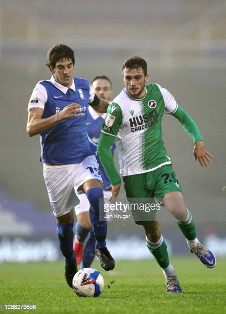 Troy Parrott of Millwall battles with Mikel San Jose of Birmingham City during the Sky Bet Championship match between Birmingham City and Millwall at...