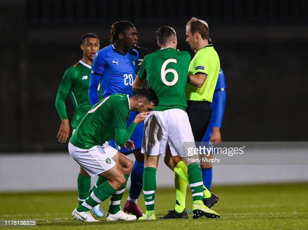 Troy Parrott of Republic of Ireland holds his face after an altercation with Moise Kean of Italy during the UEFA U21 Championships Qualifier match...