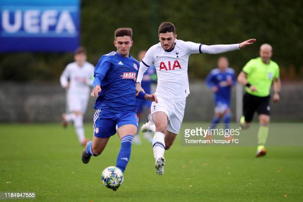 Troy Parrott of Tottenham Hotspur in action with Anastasios Boskoudis of Olympiacos during the UEFA Youth League group B match between Tottenham...