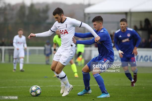 Troy Parrott of Tottenham Hotspur in action with Nikolaos Gkotzamanidis of Olympiacos during the UEFA Youth League group B match between Tottenham...