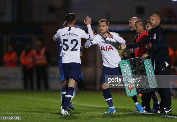 Troy Parrott of Tottenham Hotspur is substituted off for Christian Eriksen during the Carabao Cup Third Round match between Tottenham Hotspur and...