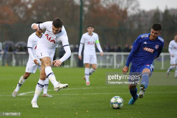 Troy Parrott of Tottenham Hotspur shoots during the UEFA Youth League group B match between Tottenham Hotspur and Olympiacos FC at Tottenham Hotspur...
