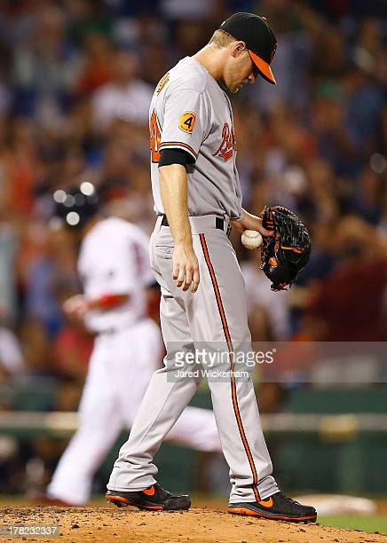 Troy Patton of the Baltimore Orioles reacts after giving up a threerun home run by Shane Victorino of the Boston Red Sox in the fifth inning during...