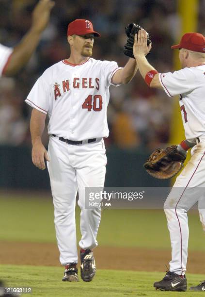 Troy Percival of the Anaheim Angels is congratulated after picking up his 301st career save in 65 victory over the Seattle Mariners at Angel Stadium