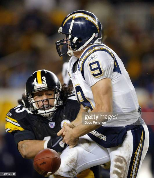 Troy Polamalu of the Pittsburgh Steelers forces a fumble as he knocks the ball from the hands of Drew Brees of the San Diego Chargers as the Steelers...