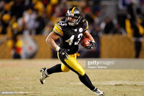 Troy Polamalu of the Pittsburgh Steelers returns an interception 40 yards for a touchdown against the Baltimore Ravens during the fourth quarter of...