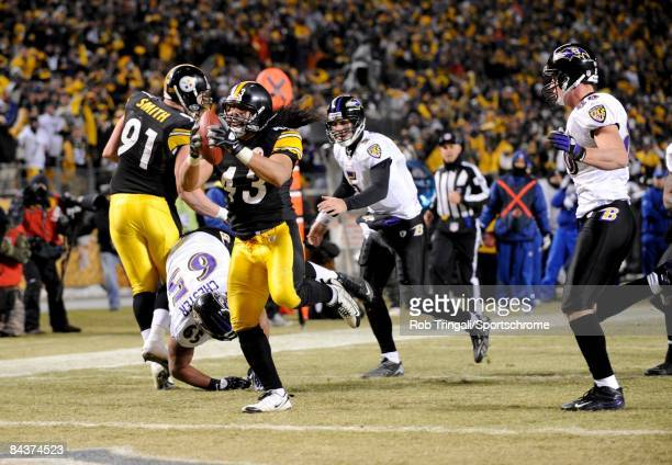Troy Polamalu of the Pittsburgh Steelers returns an interception for a touchdown in the 4th quarter against the Baltimore Ravens during the AFC...