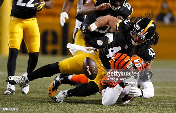Troy Polamalu of the Pittsburgh Steelers strips the ball from Jermaine Gresham of the Cincinnati Bengals during the game on December 15, 2013 at...