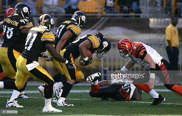 5585362c48d Troy Polamalu of the Pittsburgh Steelers takes on quarterback Carson Palmer  of the Cincinnati Bengals as