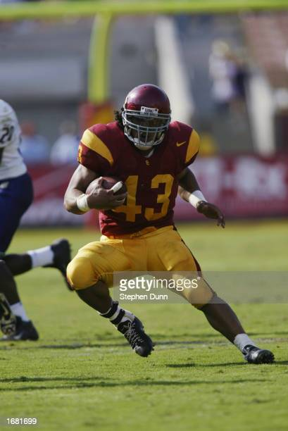 Troy Polamalu of the USC Trojans runs with the ball during the Pac10 Conference football game against the Washington Huskies at the Los Angeles...