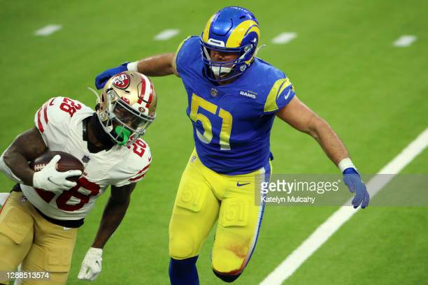 Troy Reeder of the Los Angeles Rams attempts to tackle Jerick McKinnon of the San Francisco 49ers during the fourth quarter at SoFi Stadium on...