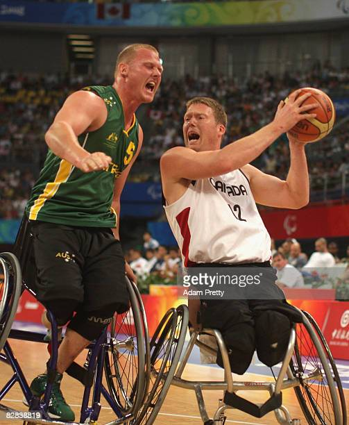 Troy Sachs of Australia collides with Patrick Anderson of Canada during the Gold Medal Wheelchair Basketball match between Australia and Canada at...