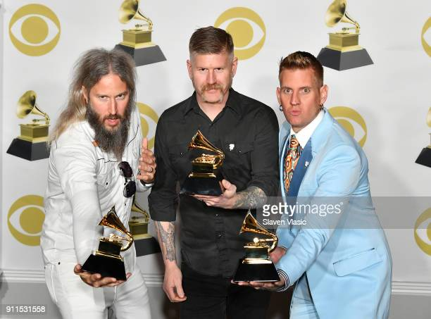 Troy Sanders Bill Kelliher and Brann Dailor of Mastodon winners of Best Metal Performance for 'Sultan's Curse' pose in the press room during the 60th...