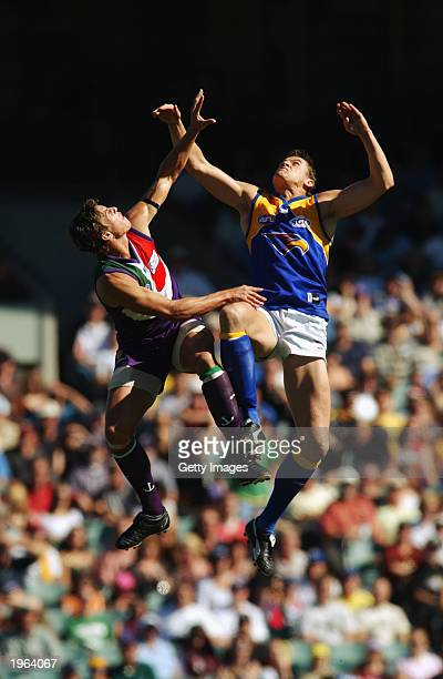 Troy Simmonds of Dockers and Michael Gardiner of Eagles contest the ruck during the round five AFL match between the Fremantle Dockers and the West...