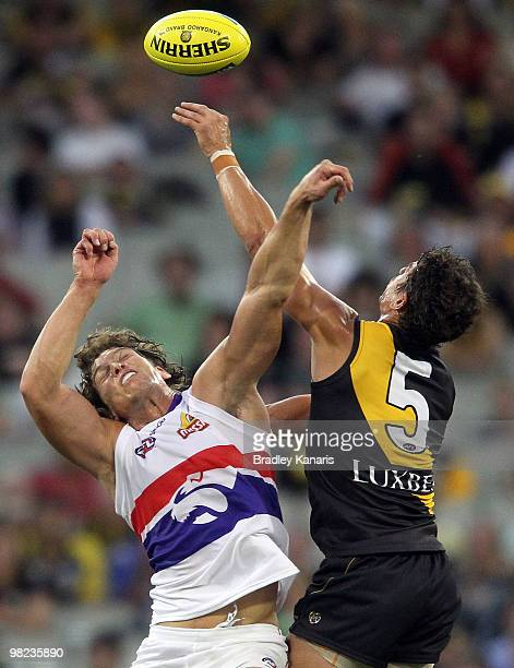 Troy Simmonds of the Tigers and Will Minson of the Bulldogs challenge for the ball during the round two AFL match between the Richmond Tigers and the...