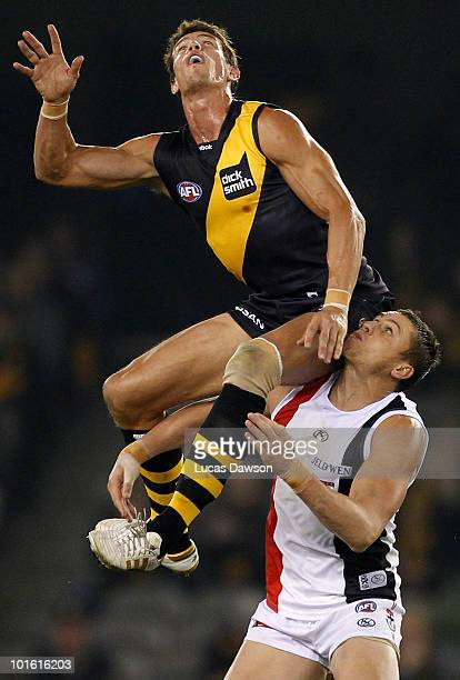 Troy Simmonds of the Tigers contests in the ruck against Michael Gardiner of the Saints during the round 11 AFL match between the Richmond Tigers and...
