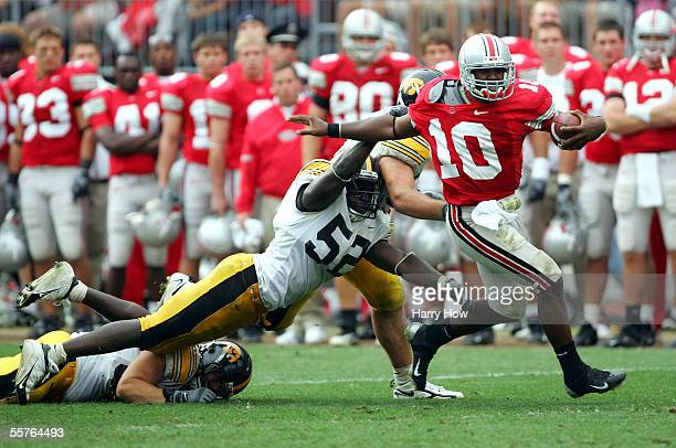 Troy Smith of Ohio State escapes the tackle of Abdul Hodge of Iowa during the third quarter on September 24 2005 at Ohio Stadium in Columbus Ohio...