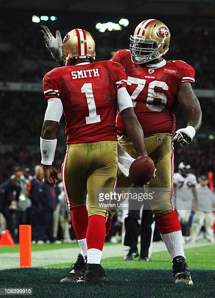 Troy Smith of San Francisco 49ers is congratulated by Anthony Davis scores their first touchdown during the NFL International Series match between...
