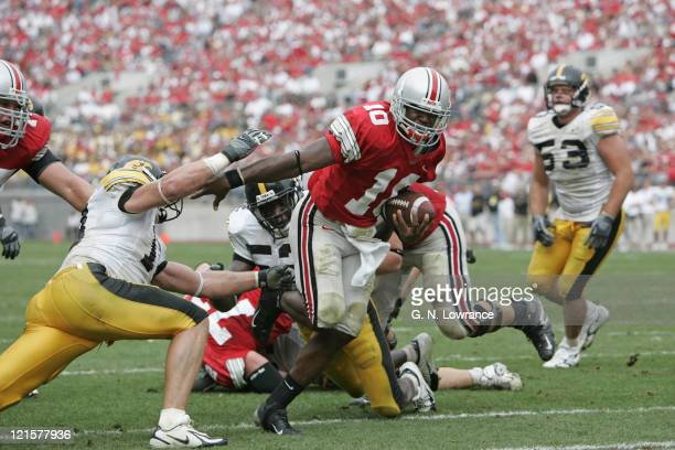 Troy Smith of the Ohio State Buckeyes breaks free to score a touchdown against the Iowa Hawkeyes at Ohio Stadium in Columbus, Ohio on Sept. 24, 2005....