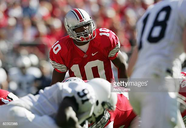 Troy Smith of the Ohio State Buckeyes calls the signals at the line during the game against the Penn State Nittany Lions at Ohio Stadium on October...