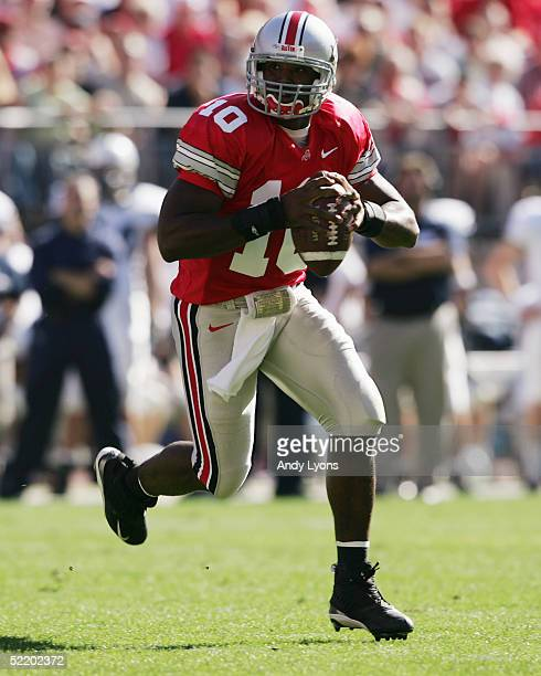 Troy Smith of the Ohio State Buckeyes rolls out to pass during the game against the Penn State Nittany Lions at Ohio Stadium on October 30 2004 in...